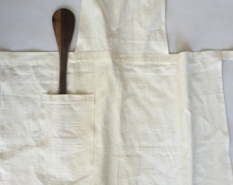 Beautiful antique linen apron with vintage mother of pearl button and red, hand stitched monogram
