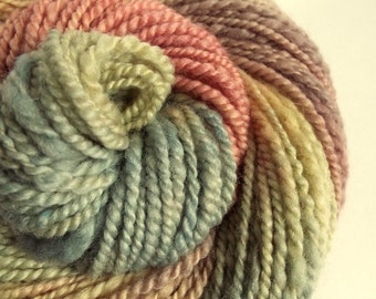 Handspun kniting yarn, pastel chunky wool, blue faced leicester yarn, thick bulky yarn, muted pinks, peach, cream, blue and lilac