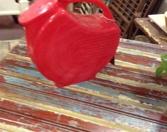Red Plastic Pitcher