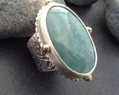 Large blue green aquamarine ring, wide band textured solid sterling silver, brass balls, raised design with delicate swirls, fits size 7