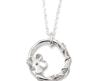 Small sterling silver Sakura flower necklace