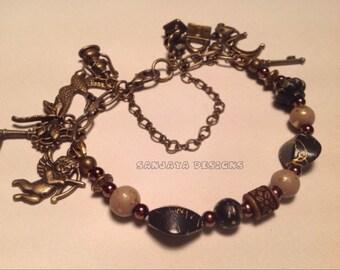 Bronze beaded charm bracelet.