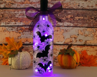 Halloween wine bottle light, hand painted black bats and spiders, purple lights