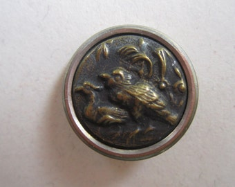 Small Vintage metal pair of birds in relief 2 piece button