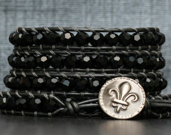 bohemian jewelry - crystal wrap bracelet- jet black crystals on pewter leather- beaded leather - fleur de lis button