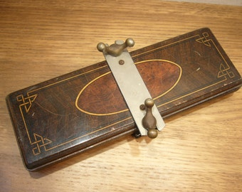 Vintage 1920s Acme wooden tie press with printed decoration