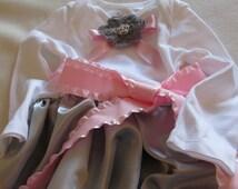 Grey satin skirt on a white long sleeved bodysuit