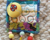 Mini quilt pin, quilted brooch, Quilt Art, fabric art