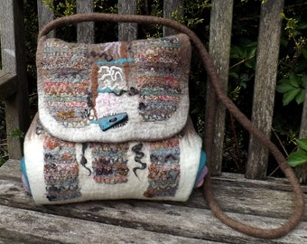 A felted handbag full of textures created from Wensleydale curls, fabrics and wools