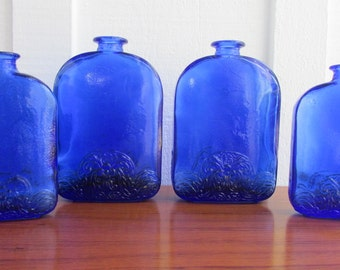 Cobalt Blue Bottles With Raised Design Nice and Heavy Set of Four