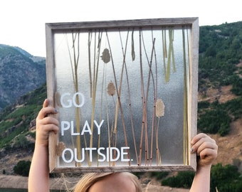 Go play outside reclaimed wood sign with pressed floral in acrylic plastic