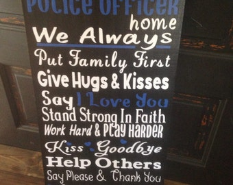 In This Police Officers Home, sign