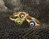 Made to order evil eye wire wrapped rings