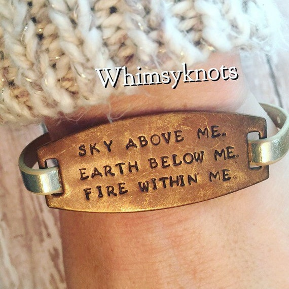 Sky above me, earth below me, fire within me-hand stamped metal and leather bracelet! Buckle closure.