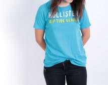 Hollister Womens M T-Shirt Blue Cotton Rip Tide Series Short Sleeve jersey Surfing College