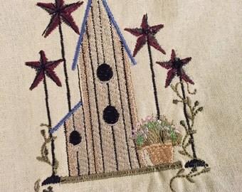 A beautiful primitive salt box and stars hand/dish towel