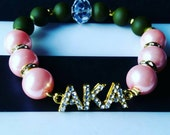 """Arm Candy. Golden """"Roses and Stems"""" Rhinestone AKA inspired. Pink and Green. Alpha Kappa Alpha"""