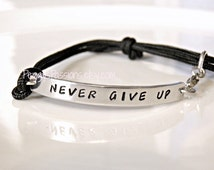 Never Give Up, Inspirational Hand Stamped Bracelet with durable paracord.