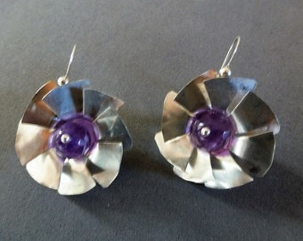 Silver Pinwheel Earrings are shining sterling silver spinners orbiting faceted amethyst beads, on Argentium silver beaded French earwires.