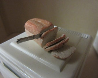 1/12 scale Dolls House Food Loaf Of Bread being cut DHD76