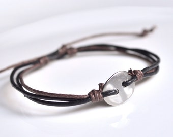 Stainless steel bracelet black leather cord button