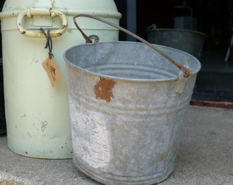 Galvanized rusty pail with rounded base
