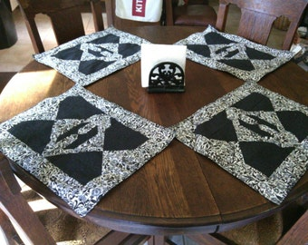 Handmade set of 4 quilted placemats in black & white.