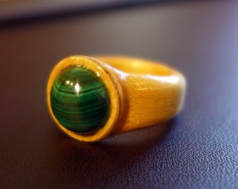 Bent wood primavera ring with malachite stone and laser cut setting