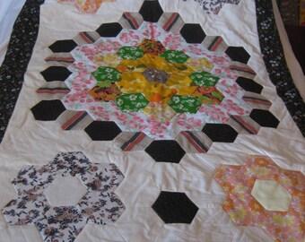 Chocolate, cream and orange patchwork quilt