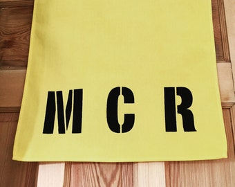 MCR Manchester Graphic Kitchen Tea Towel in Yellow + Black