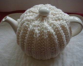 Hand Knitted Tea Cosy In Aran Colour Cream