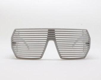 Shutter sunglasses, 80s style eyewear glasses in grey.