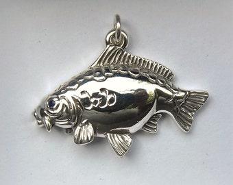 Mirror carp necklace , silver and sapphire pendant.