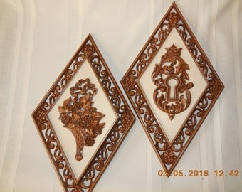 Vintage gold plastic wall hanging.