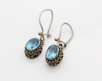 Sterling Silver and Faceted Blue Topaz Dangle Earrings MNSN. [6120]