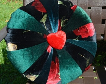Unique 15 inch round quilted velvet pillow with heart medallions