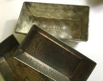 Vintage collection of Ovenex / Bake King starburst bread pans