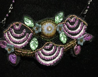 """Hand beaded neckpiece.....one of a kind.....approximately 3 3/4"""" X 2 1/2"""""""