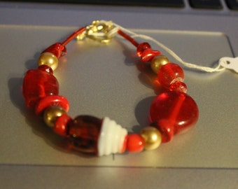Handmade bracelet, red and black glass beads, cupcake and various beads
