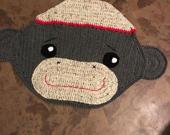 Crocheted sock monkey rug