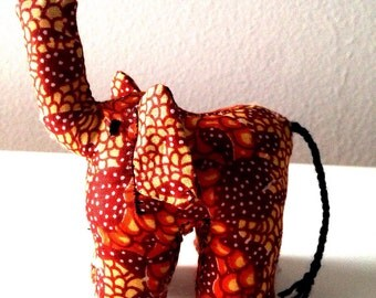 "Small Elephant #01182 made by Ugandan Disabled Women. 4"" height and 5"" wide"