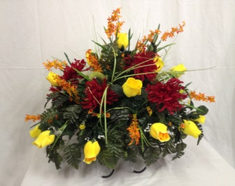 Cemetery Saddle Yellow Rose Buds, Red Mums, Pompous Grass, Orange Bellflowers, Orange and Yellow Filler Flowers, Green Silk Fern