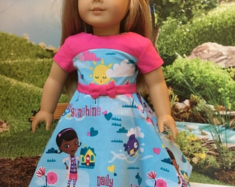 "18"" doll dress. Handmade be me in my smoke free pet friendly home.  Pretty dress made out of another doc mc stuffins fabric. Detachable belt"
