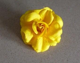 Small yellow fabric flower