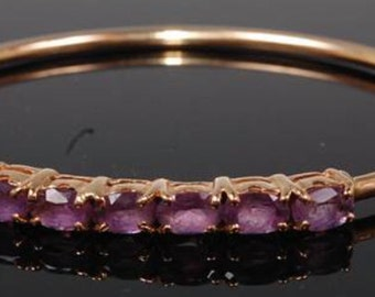 A 9ct Gold Bangle Set With Amethysts
