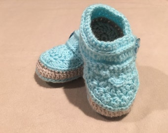 Little shoes for sitting or crawling baby