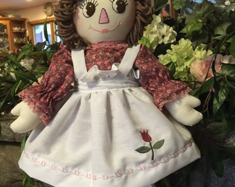"20"" Raggedy Ann with tulip on apron."
