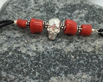 Bracelet man in coral Corsica and skulls