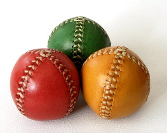 Set of three leather juggling balls