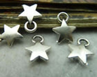 Silver puffed star charm 10 charms
